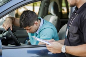 Police writing motorist a ticket