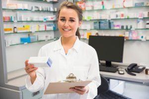 Junior pharmacist holding medicine box