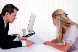Woman consulting attorney