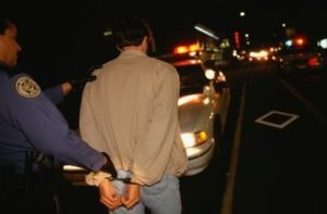 Man being arrested at night