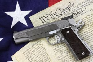 Gun sitting on top of copy of constitution